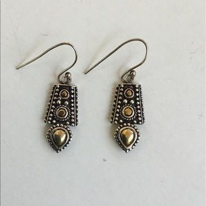 Silver and brass colored earrings
